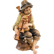 Herdsman sitting with bagpipe 10 cm Serie Colored maple