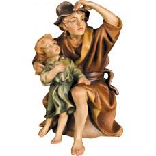 Herdsman sitting with kid